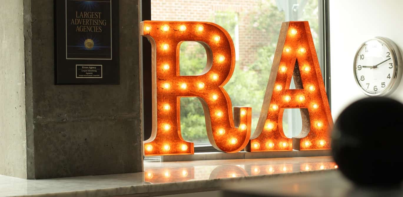 Photograph of lights shaped in RA initials in Lauren Rivers' office