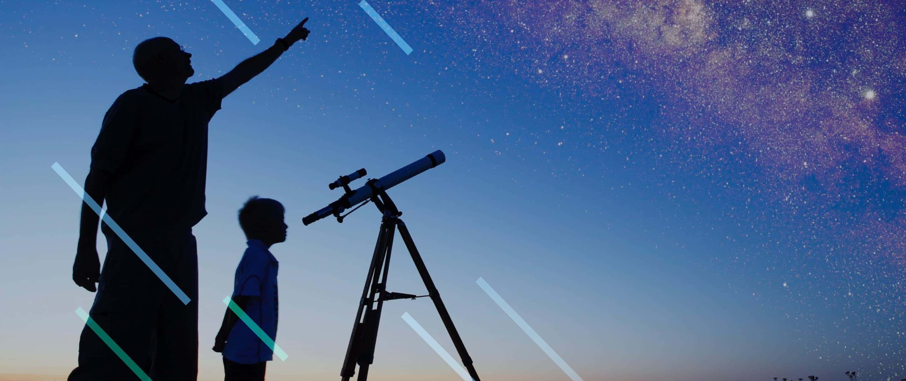 Morehead Planetaium man and boy looking at stars with telescope