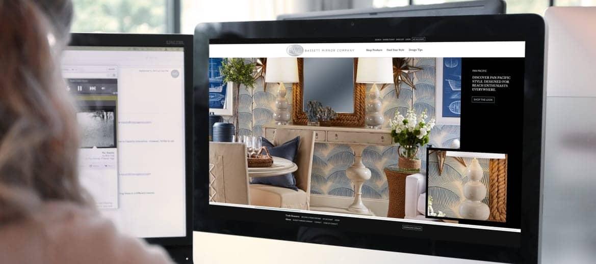 Designer working on the Bassett Mirror Company website layout