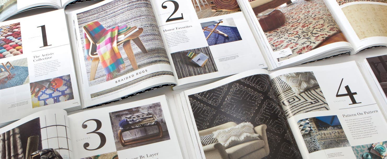 A stack of Capel Rugs catalogs