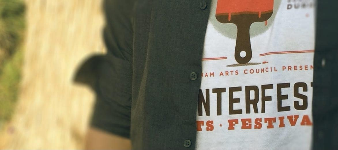 A person wearing a CenterFest Arts Festival t-shirt
