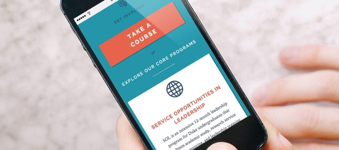 Mobile phone showing the Hart Leadership Program website