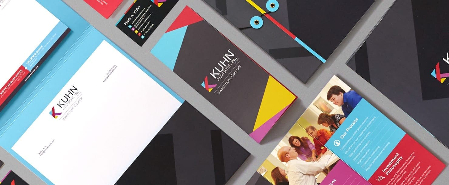 Kuhn Advisors print designs layed out on a table