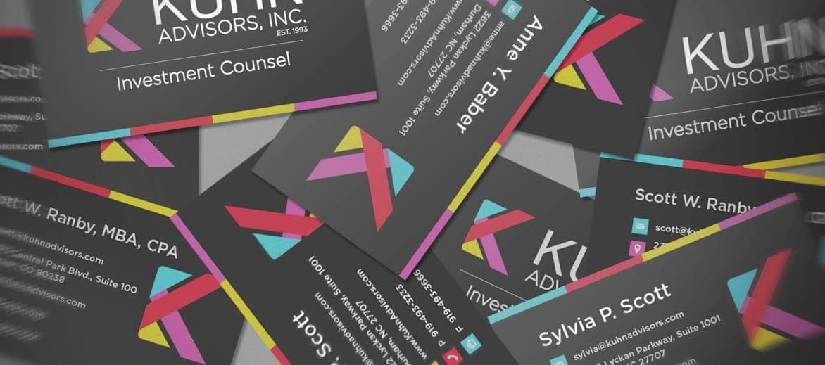 Business cards with the Kuhn Advisors logo