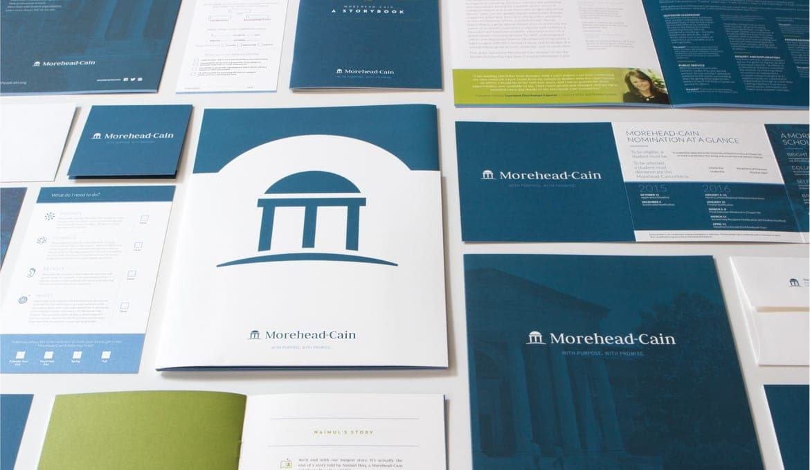 The Morehead-Cain Scholarship print designs layed out on a table