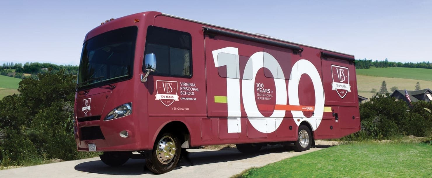 Hero image of a red bus with the Virginia Episcopal School logo and design