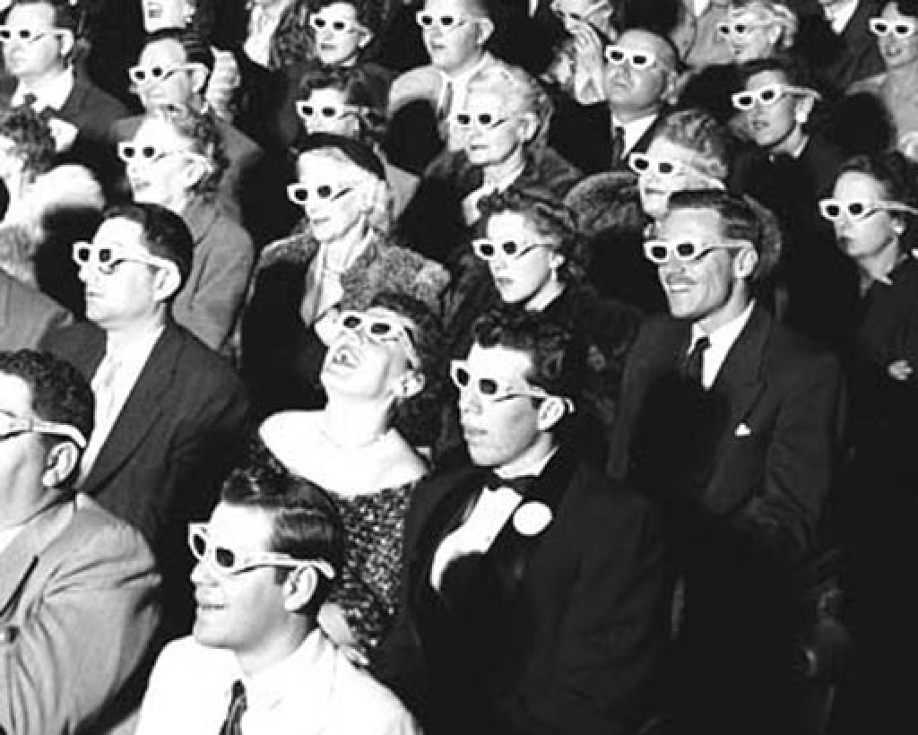 early 20th century photo of cinema with people wearing 3d glasses