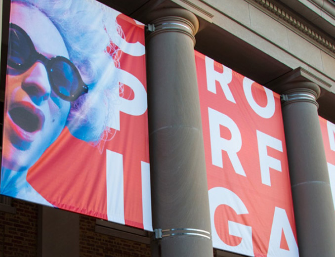 Carolina Performing Arts banner designed by Rivers Agency hanging in front of Memorial Hall