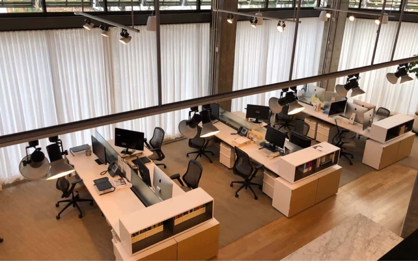 A view of the Rivers office with computers and empty desks